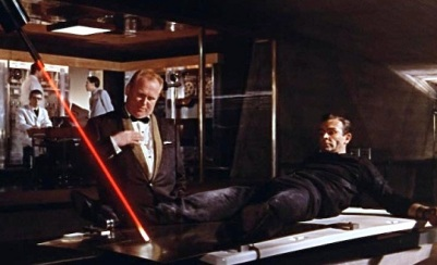 In order to buy time, Bond asks Gert Fröbe  (Auric Goldfinger)   Do you expect me to talk? No Mr. Bond, I expect you to die. This was the first movie to feature a laser.